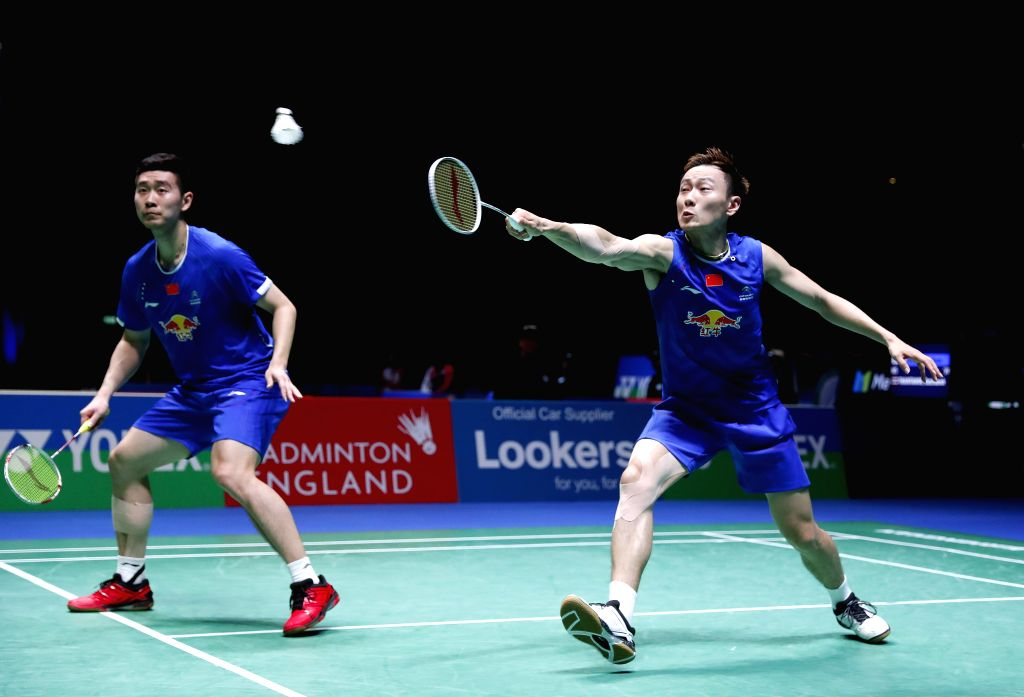 BIRMINGHAM, Mar. 11, 2017 - Liu Cheng/Zhang Nan (R) of China compete during the men's doubles semifinal against their teammates Li Junhui/Liu Yuchen at All England Open Badminton Championships 2017 ...