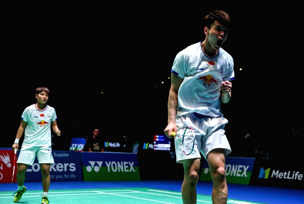 BIRMINGHAM, March 10, 2017 - China's Wang Yilyu (R) and Huang Dongping celebrate during the mixed doubles second round match with Zheng Siwei and Chen Qingchen of China at All England Open Badminton ...