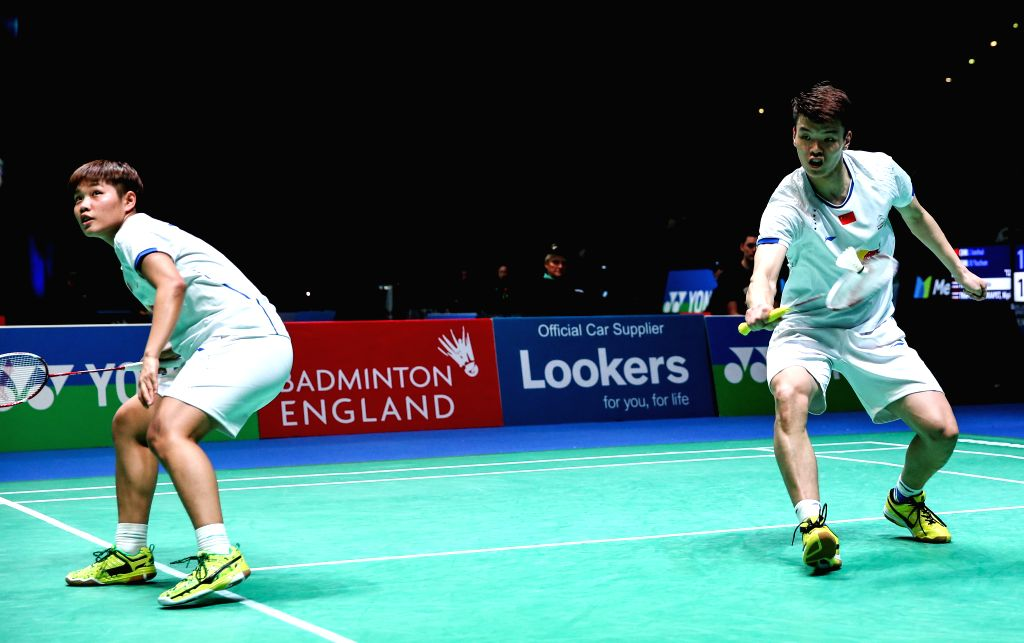 BIRMINGHAM, March 10, 2017 - China's Wang Yilyu (R) and Huang Dongping compete during the mixed doubles second round match with Zheng Siwei and Chen Qingchen of China at All England Open Badminton ...