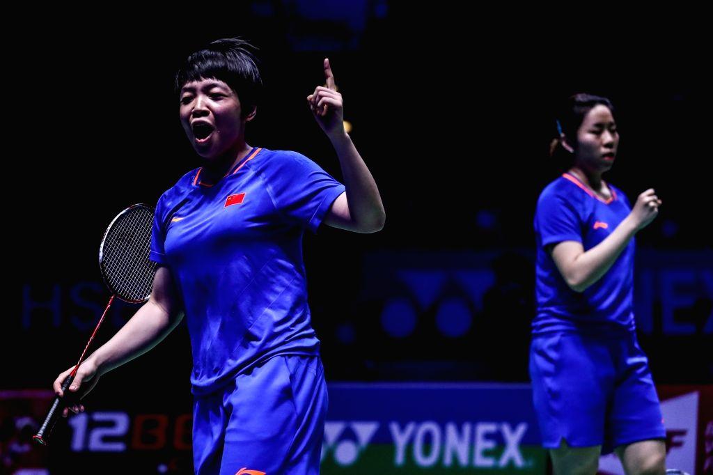 BIRMINGHAM, March 10, 2019 - China's Chen Qingchen (L)/Jia Yifan react during the women's doubles semifinal match with Japan's Yuki Fukishima and Sayaka Hirota  at the All England Open Badminton ...