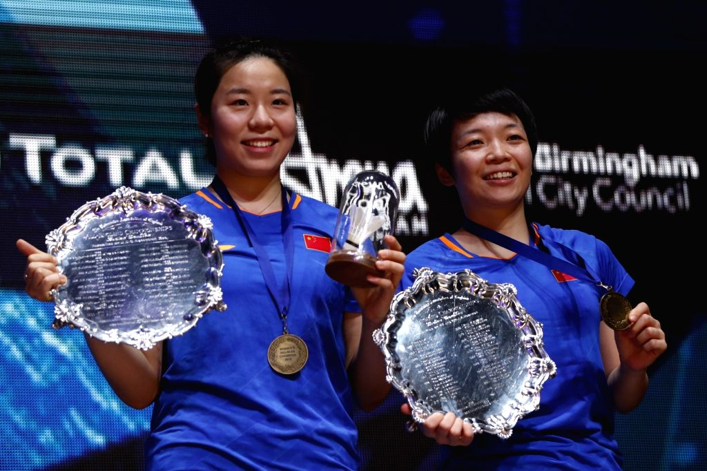BIRMINGHAM, March 10, 2019 - China's Chen Qingchen (L)/Jia Yifan react during the awarding ceremony for women's doubles at the All England Open Badminton Championships 2019 in Birmingham, Britain on ...