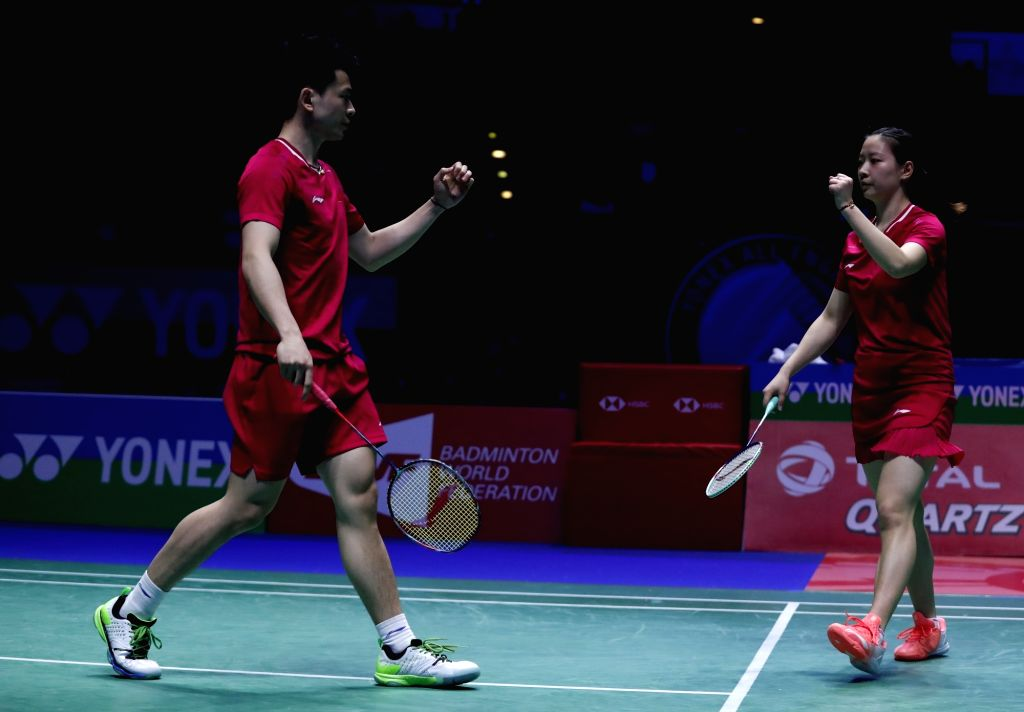 BIRMINGHAM, March 10, 2019 - China's Zheng Siwei (L)/Huang Yaqiong celebrate during the mixed doubles semifinal match with Indonesia'sPraveen Jordan/Melati Daeva Oktaviani at the All England Open ...