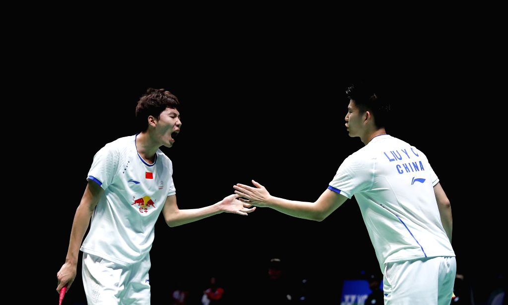 BIRMINGHAM, March 11, 2017 - Li Junhui (L)/Liu Yuchen of China celebrate during the men's doubles semifinal against their teammates Liu Cheng/Zhang Nan at All England Open Badminton Championships ...