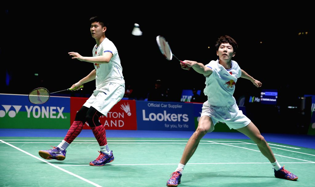 BIRMINGHAM, March 11, 2017 - Li Junhui (R)/Liu Yuchen of China compete during the men's doubles semifinal against their teammates Liu Cheng/Zhang Nan at All England Open Badminton Championships 2017 ...