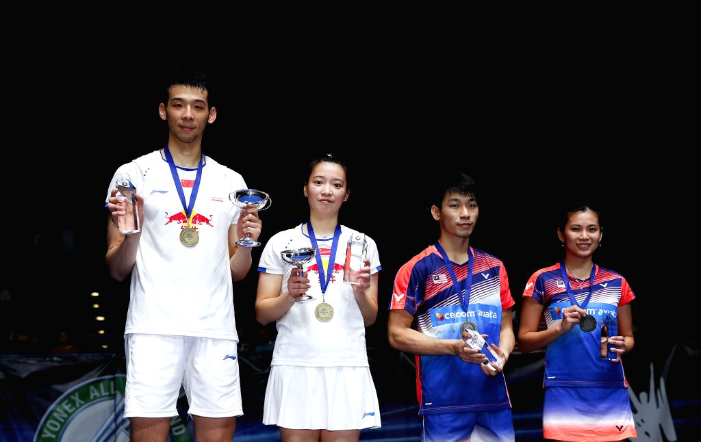 BIRMINGHAM, March 12, 2017 - Lu Kai(1st,L)/Huang Yaqiong(2nd,L) of China and Peng Soon Chan(2nd,R)/Liu Ying Goh of Malaysia pose on the podium during the awarding ceremony after the mixed doubles ...