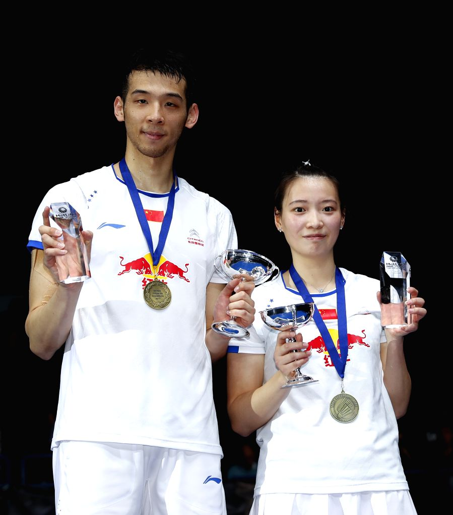 BIRMINGHAM, March 12, 2017 - Lu Kai(L)/Huang Yaqiong of China pose on the podium during the awarding ceremony after the mixed doubles final with Peng Soon Chan/Liu Ying Goh of Malaysia at All England ...