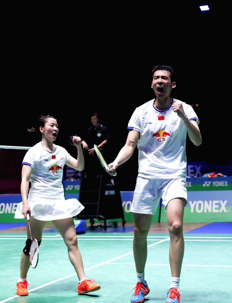 BIRMINGHAM, March 12, 2017 - Lu Kai (R)/Huang Yaqiong of China celebrate during the mixed doubles final with Peng Soon Chan/Liu Ying Goh of Malaysia at All England Open Badminton Championships 2017 ...