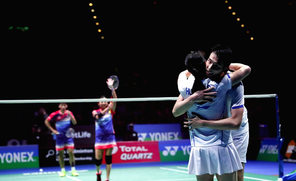 BIRMINGHAM, March 12, 2017 - Lu Kai(R)/Huang Yaqiong of China celebrate after the mixed doubles final with Peng Soon Chan/Liu Ying Goh of Malaysia at All England Open Badminton Championships 2017 in ...