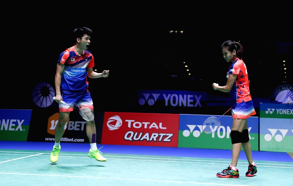BIRMINGHAM, March 12, 2017 - Peng Soon Chan (L)/Liu Ying Goh of Malaysia celebrate during the mixed doubles final with Lu Kai/Huang Yaqiong of China at All England Open Badminton Championships 2017 ...
