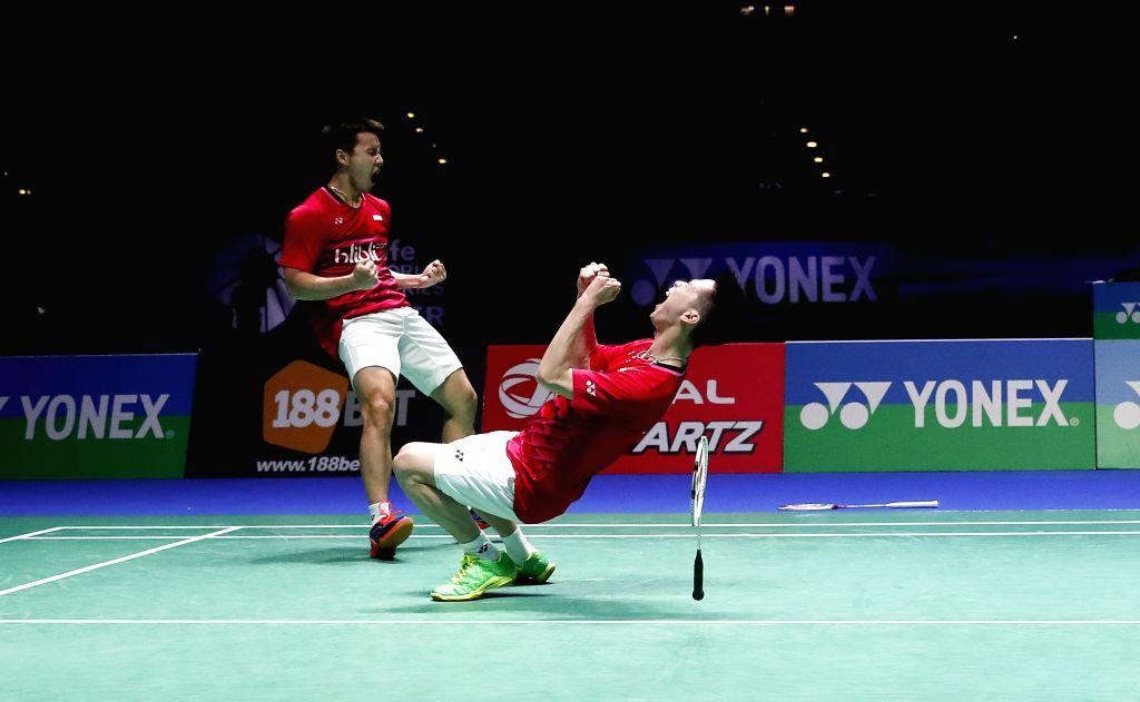 BIRMINGHAM, March 13, 2017 - Marcus Fernaldi Gideon/Kevin Sanjaya Sukamuljo (R) of Indonesia celebrate victory during the men's doubles final with Li Junhui/Liu Yuchen of China at All England Open ...
