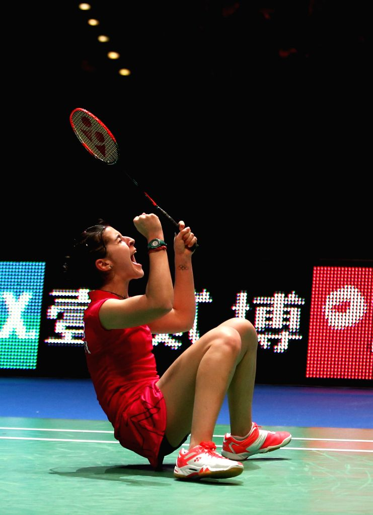 Carolina Marin of Spain celebrates after the women's singles final against Saina Nehwal of India at the All England Open Badminton Championships at Barclaycard ...