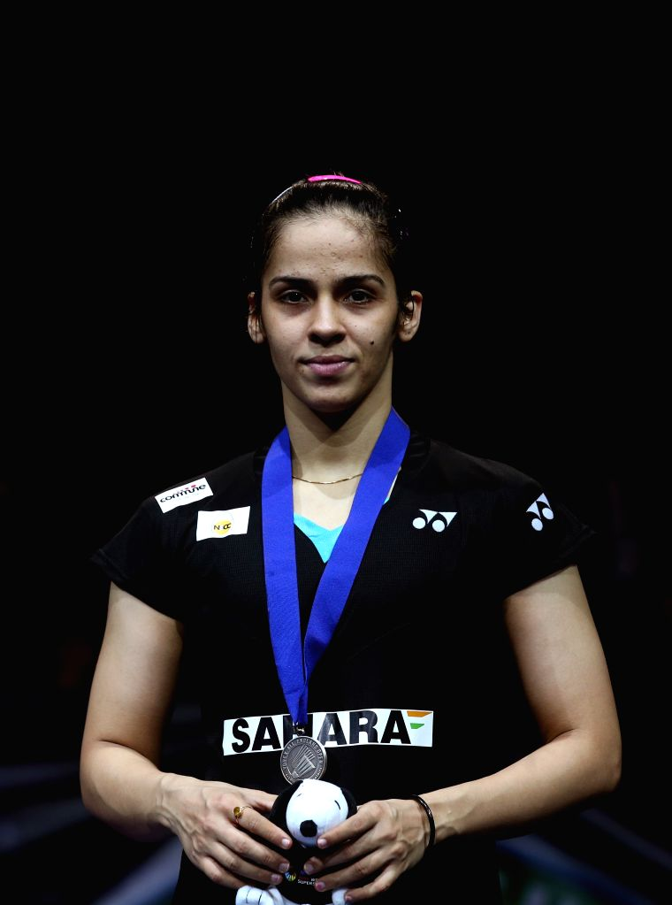 Saina Nehwal of India poses on the podium after the women's singles final against Carolina Marin of Spain at the All England Open Badminton Championships at ...