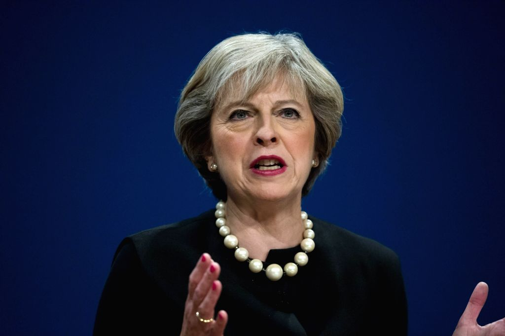 BIRMINGHAM, Oct. 2, 2016 - British Prime Minister Theresa May speaks on the first day of the Conservative Party Conference at the International Convention Centre in Birmingham, Britain on Oct. 2, ... - Theresa May