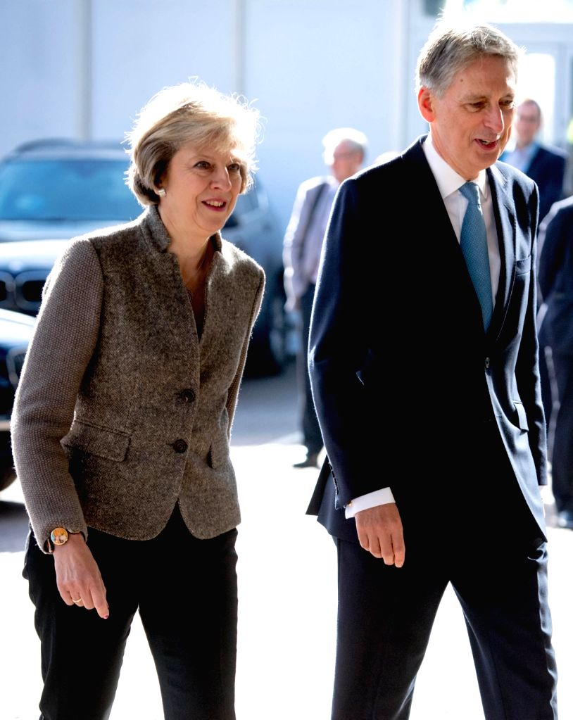 BIRMINGHAM, Oct. 3, 2016 - British Prime Minister Theresa May (L) and the Chancellor of the Exchequer Philip Hammond visit a construction site where new HSBC offices are being built on Day Two of the ... - Theresa May