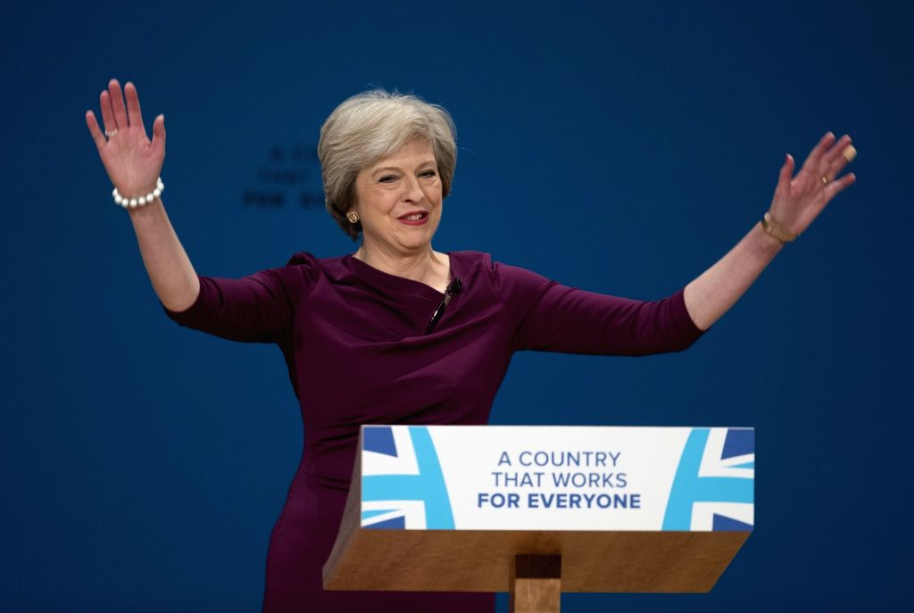 BIRMINGHAM, Oct. 5, 2016 - British Prime Minister Theresa May greets the audience before giving a speech on the final day of the Conservative Party Conference in Birmingham, Britain, on Oct. 5, 2016. ... - Theresa May