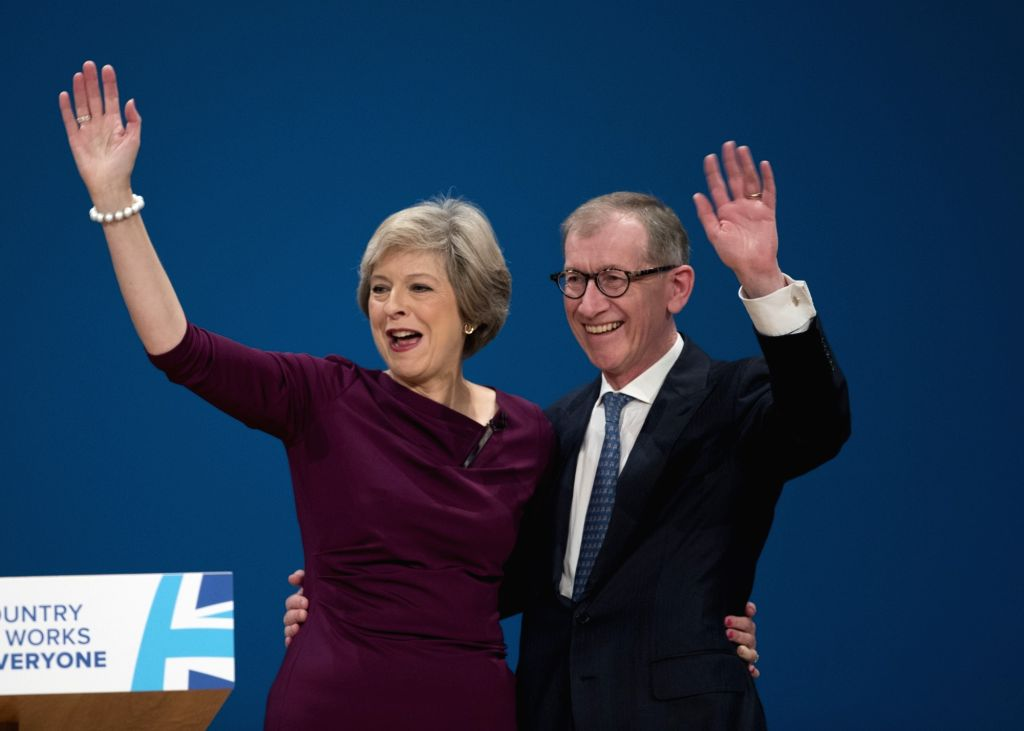 BIRMINGHAM, Oct. 5, 2016 - British Prime Minister Theresa May (L) and her husband Philip greet the audience after her speech on the final day of the Conservative Party Conference in Birmingham, ... - Theresa May