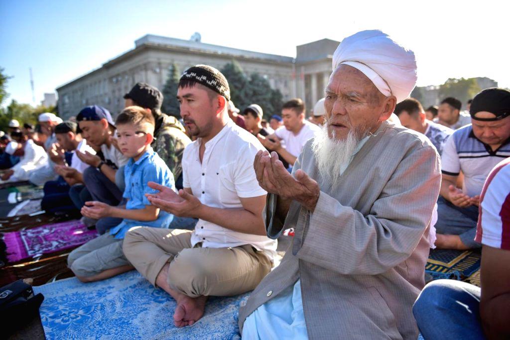 BISHKEK, Aug. 11, 2019 - Muslims take part in an Eid Al-Adha prayer in Bishkek, Kyrgyzstan, Aug. 11, 2019.