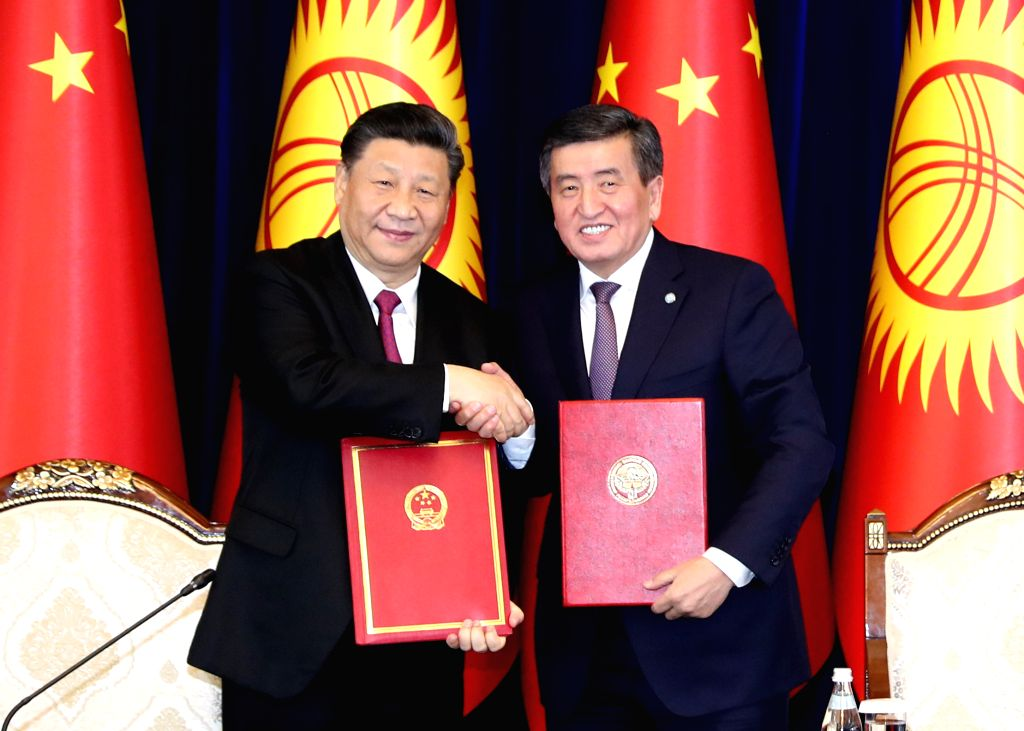 BISHKEK, June 13, 2019 - Chinese President Xi Jinping shakes hands with his Kyrgyz counterpart Sooronbay Jeenbekov after signing the joint statement on taking their countries' comprehensive strategic ...