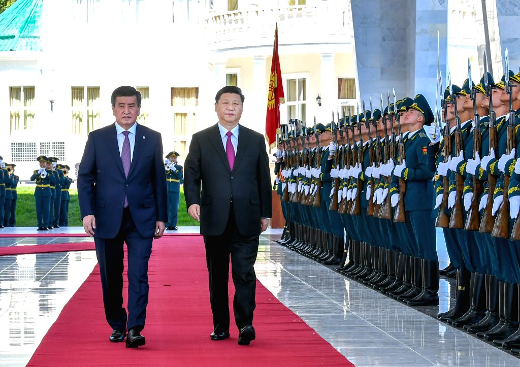 BISHKEK, June 13, 2019 - Chinese President Xi Jinping and his Kyrgyz counterpart Sooronbay Jeenbekov inspect the guard of honor during a welcome ceremony held by Jeenbekov in Bishkek, Kyrgyzstan, ...
