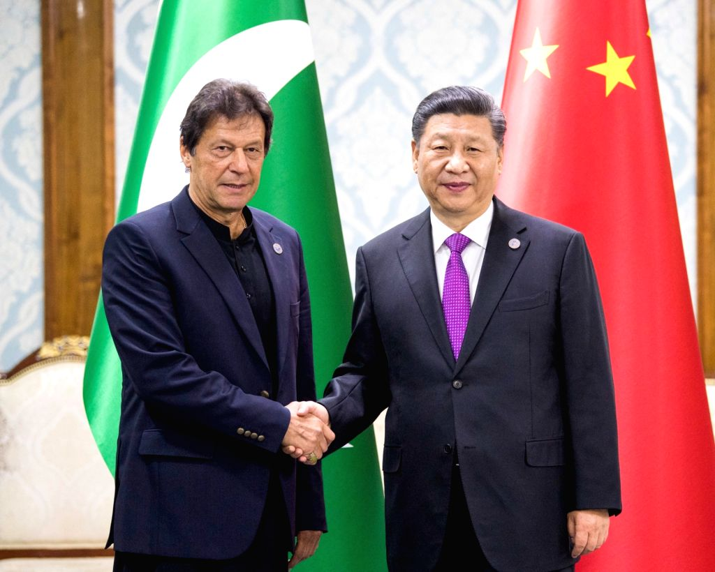 BISHKEK, June 14, 2019 - Chinese President Xi Jinping (R) meets with Pakistani Prime Minister Imran Khan in Bishkek, Kyrgyzstan, June 14, 2019. - Imran Khan