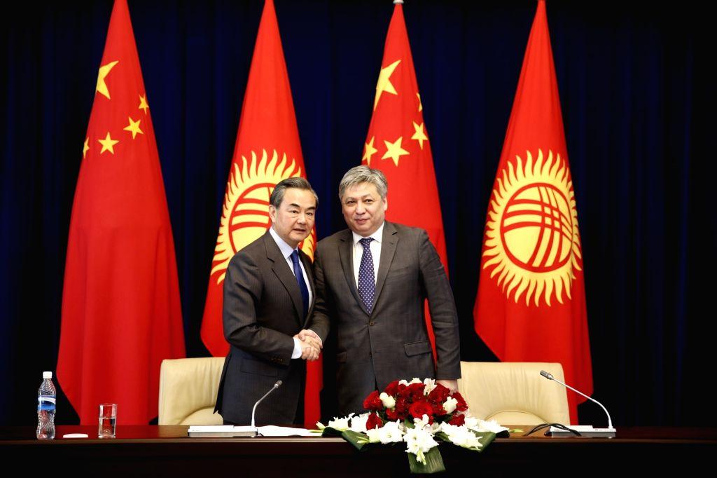 BISHKEK, May 22, 2016 - Chinese Foreign Minster Wang Yi (L) and his Kyrgyz counterpart Erlan Abdyldaev meet media after their talks in Bishkek, Kyrgyzstan, May 22, 2016.