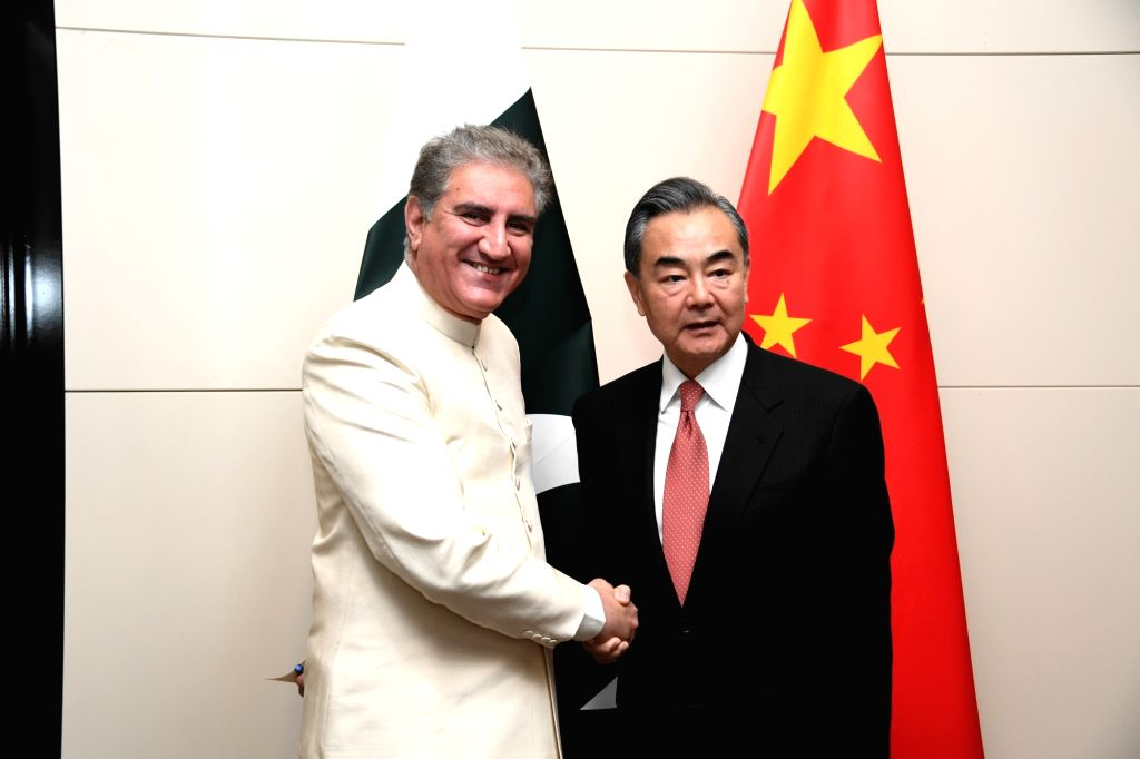BISHKEK, May 23, 2019 (Xinhua) -- Chinese State Councilor and Foreign Minister Wang Yi (R) meets with Pakistani Foreign Minister Shah Mahmood Qureshi on the sidelines of the Shanghai Cooperation Organization (SCO) Foreign Ministers' meeting in Bishke - Wang Y and Mahmood Qureshi