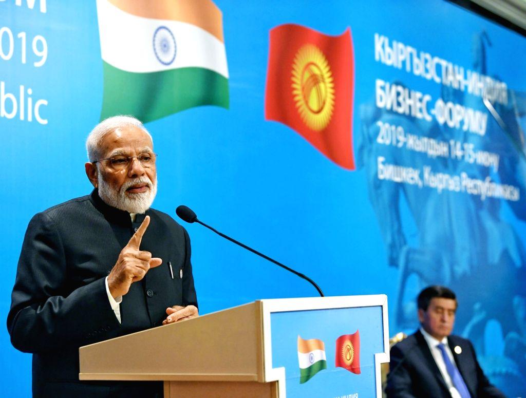 Bishkek: Prime Minister Narendra Modi addresses at India-Kyrgy Business Forum in Bishkek, Kyrgyzstan on June 14, 2019. (Photo: IANS/PIB) - Narendra Modi