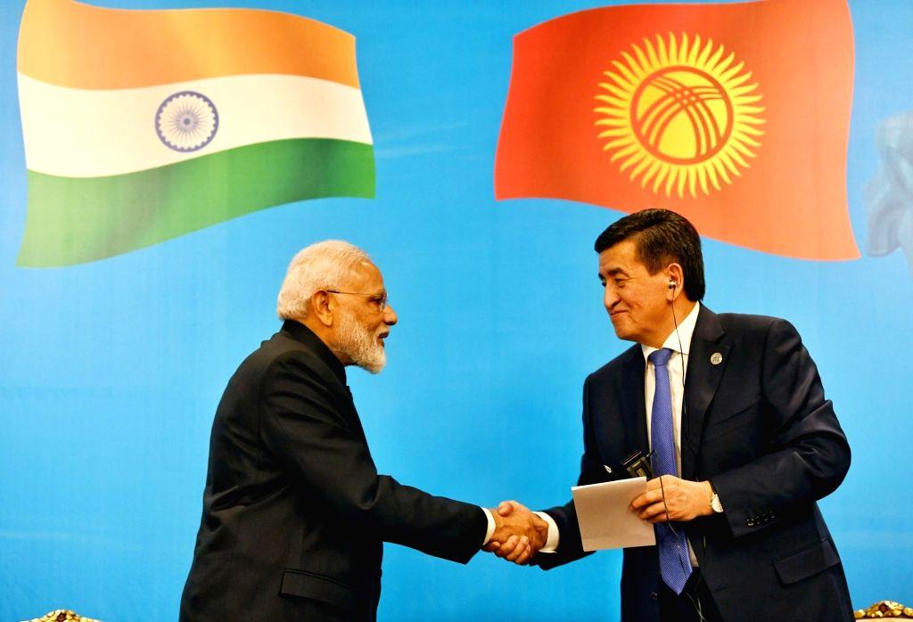 Bishkek: Prime Minister Narendra Modi and Kyrgyzstan President Sooronbay Jeenbekov at the inauguration of India-Kyrgy Business Forum in Bishkek, Kyrgyzstan on June 14, 2019. (Photo: IANS/PIB) - Narendra Modi