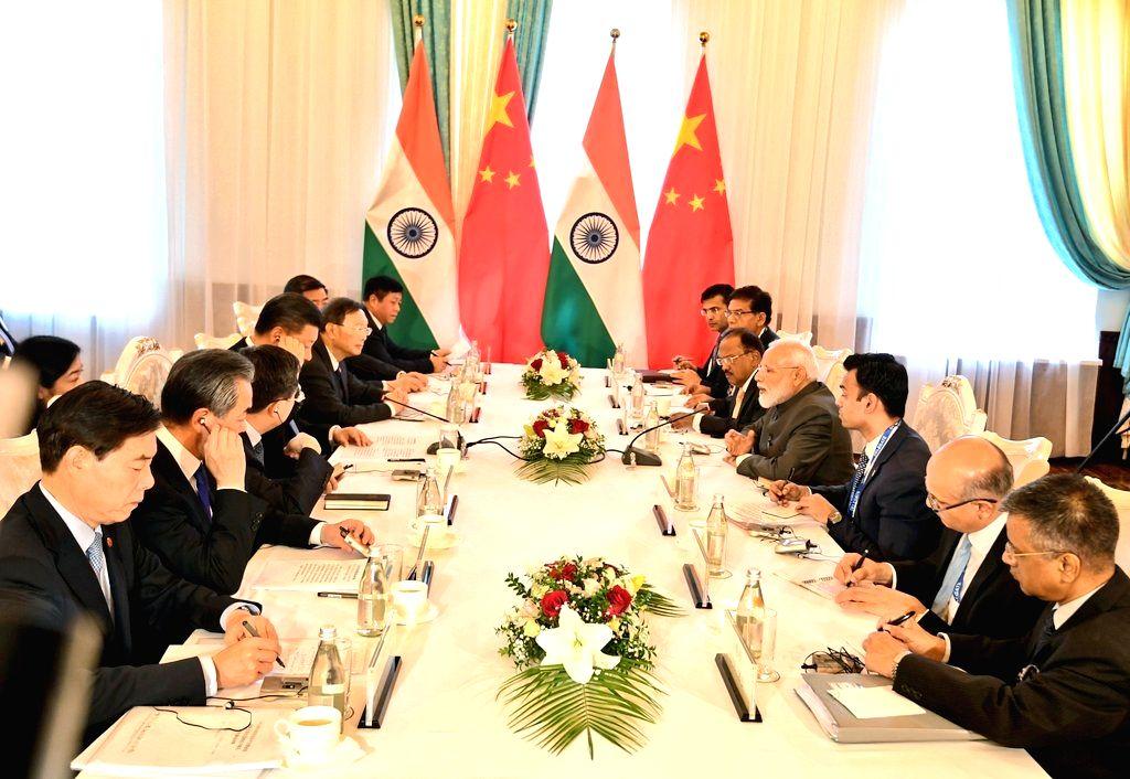Bishkek: Prime Minister Narendra Modi meets Chinese President Xi Jinping in Bishkek, Kyrgyzstan on June 13, 2019. (Photo: IANS/MEA) - Narendra Modi