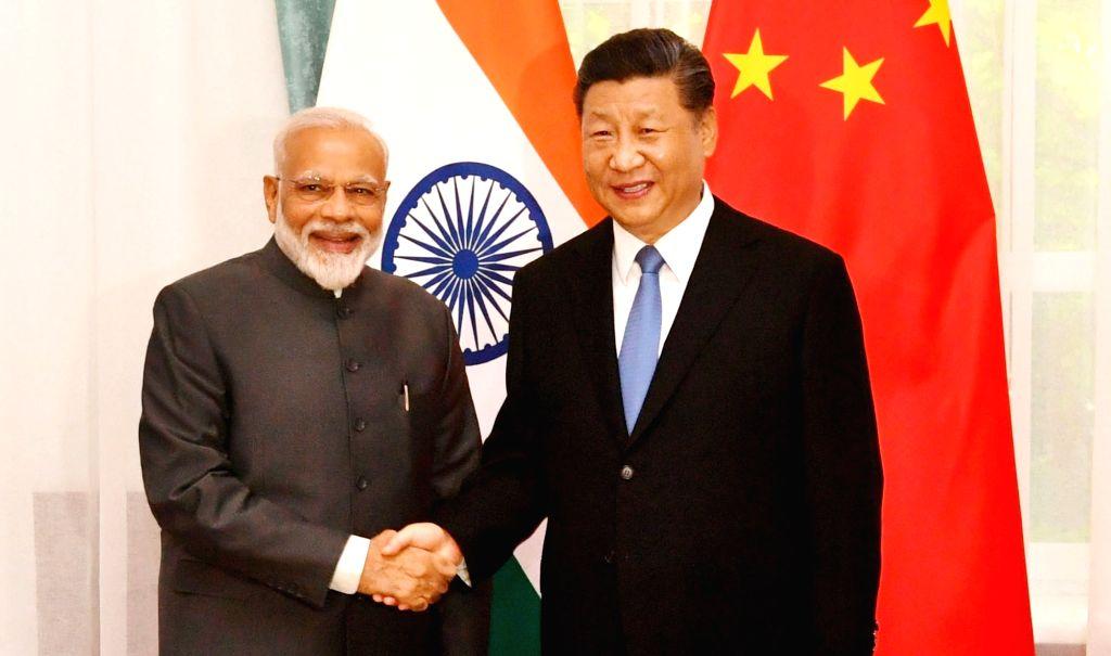Bishkek: Prime Minister Narendra Modi meets Chinese President Xi Jinping on the sidelines of the SCO Summit in Bishkek, Kyrgyz Republic on June 13, 2019. (Photo: IANS/PIB) - Narendra Modi