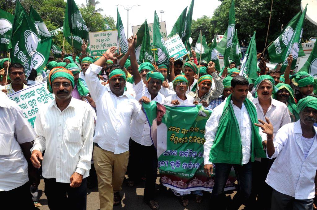 BJD Krushak cell workers participate in Bhubaneswar, on June 23, 2017. (Photo : Arabinda Mahapatra/IANS)