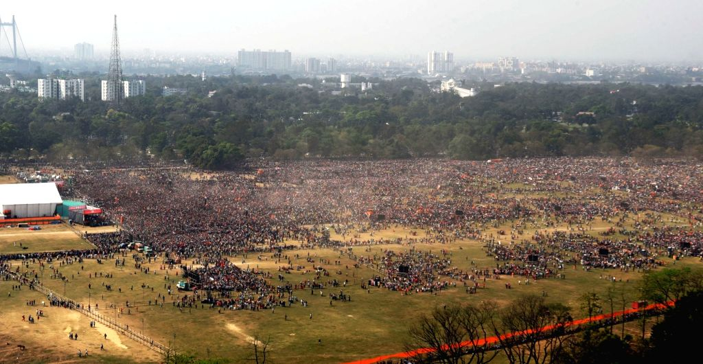 BJP activists at Brigade Parade Ground during BJP public meeting for Prime Minister Narendra Modi's rally ahead of State Assembly election in Kolkata on March 7, 2021. - Narendra Modi