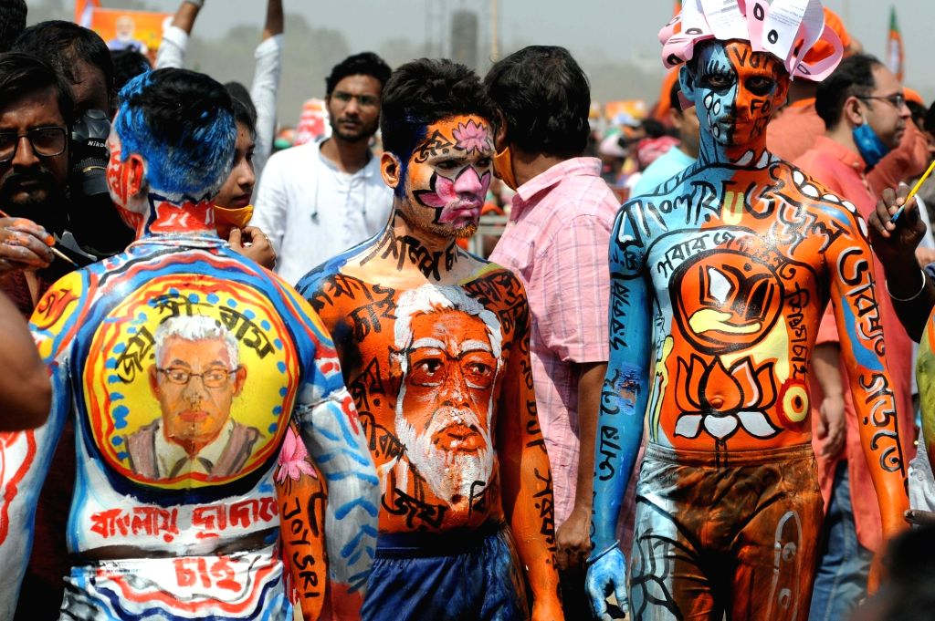 BJP activists at Brigade Parade Ground to attend Indian Prime minister Narendra Modi's public meeting ahead of the State Assembly election in Kolkata on March 7, 2021. - Narendra Modi