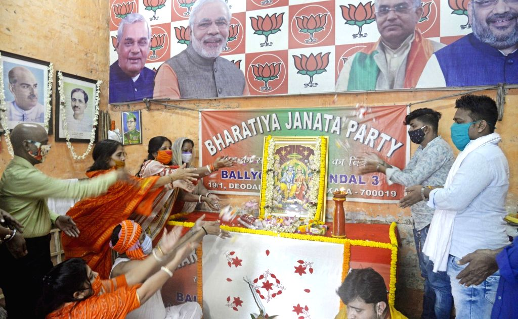 BJP activists offer prayers to Lord Ram to mark the occasion of Ram Temple 'Bhumi Pujan' in Ayodhya performed by Prime Minister Narendra Modi today; in Kolkata on Aug 5, 2020. - Narendra Modi
