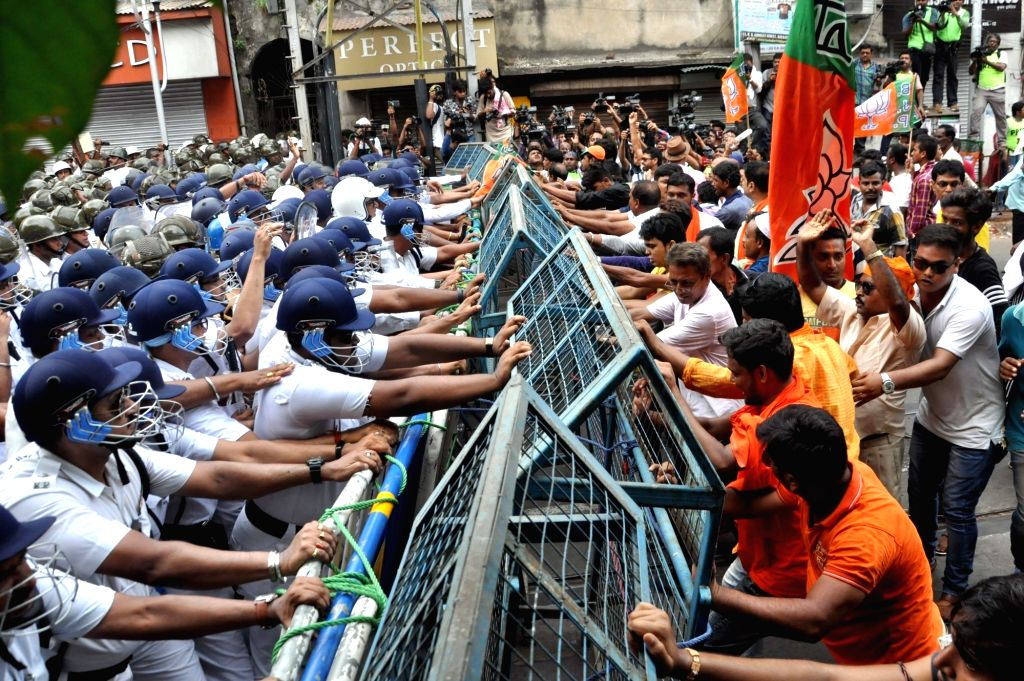 BJP activists stage a protest march against the killing of its party men in West Bengal, from Lalbazar to Kolkata Police Headquarters on June 12, 2019.