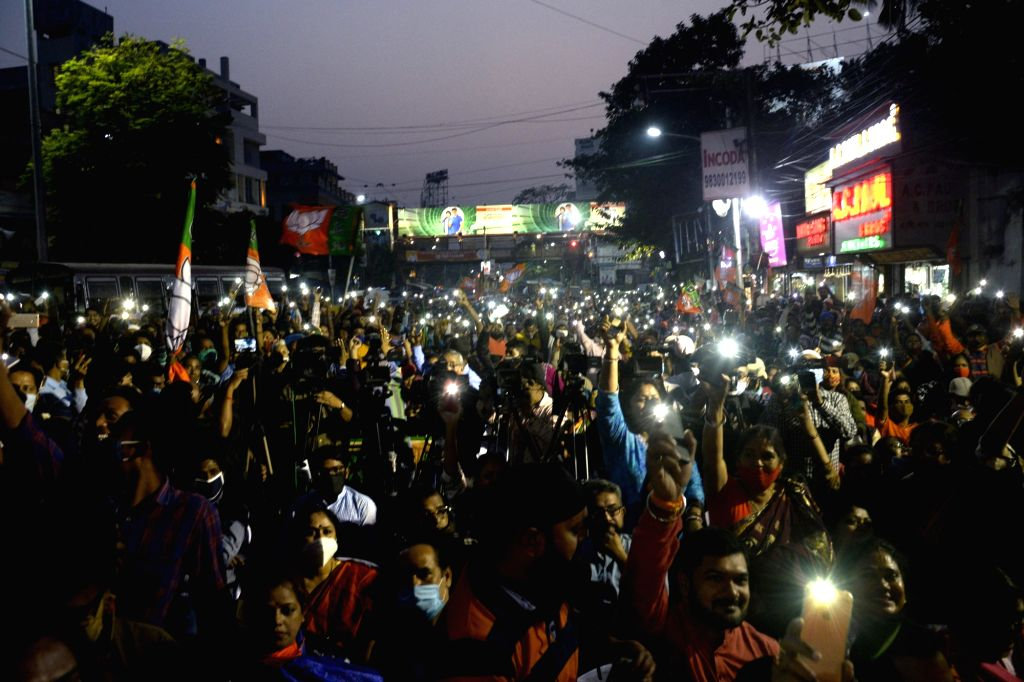 "BJP activists switch on their mobile flash lights during ""Ar Noy Annay"" rally organised to protest against the West Bengal Government, in Kolkata on Dec 3, 2020."
