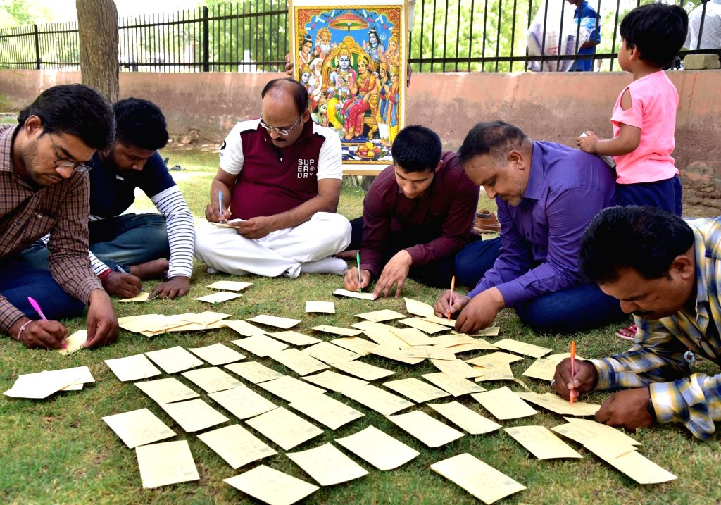 "BJP activists write ""Jai Sri Ram"" on postcards that will be sent to West Bengal Chief Minister Mamata Banerjee, in Bikaner on June 3, 2019. Banerjee on Thursday lost her cool for ... - Mamata Banerjee and Barackpore Arjun Singh"