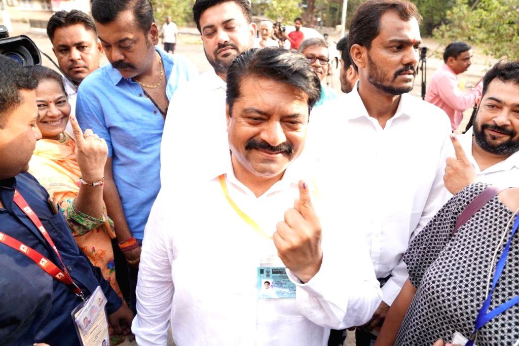 BJP candidate for Mumbai North East Lok Sabha seat, Manoj Kotak shows his forefinger marked with indelible ink after casting vote during the fourth phase of 2019 Lok Sabha elections in Mumbai ...