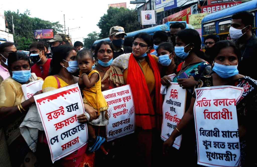 BJP Candidate from bhawanipure constituency Priyanka Tebrewal with alleged victims of political violence by TMC cadre during a protest against State Government in Kolkata on Saturday ...