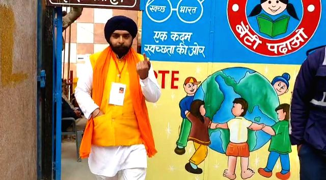 BJP candidate from Hari Nagar, Tajinder Pal Singh Bagga shows his inked finger after casting his vote for the Delhi Assembly elections 2020, on Feb 8, 2020.
