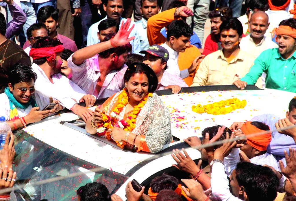 BJP candidate Neelam Karwariya celebrates after her victory in Uttar Pradesh assembly elections in Allahabad on March 11, 2017.