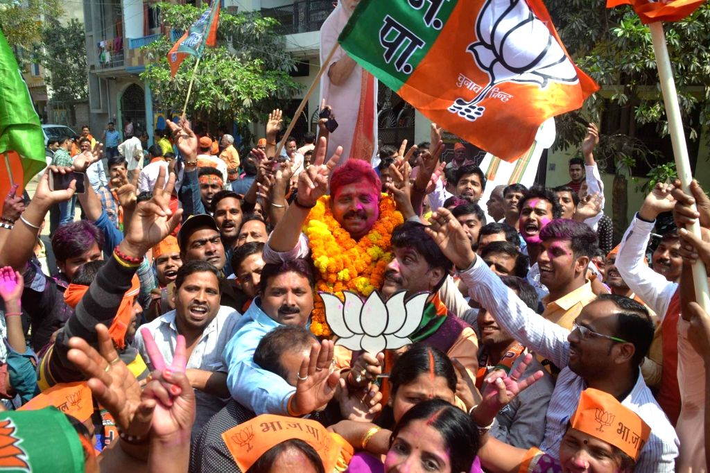 BJP candidate Ravindra Jaiswal celebrates with party workers as assembly election results being announced in Varansi on March 11, 2017.
