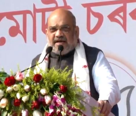BJP chief Amit Shah addresses a party meeting in Assam's Lakhimpur district, on Feb 17, 2019. - Amit Shah