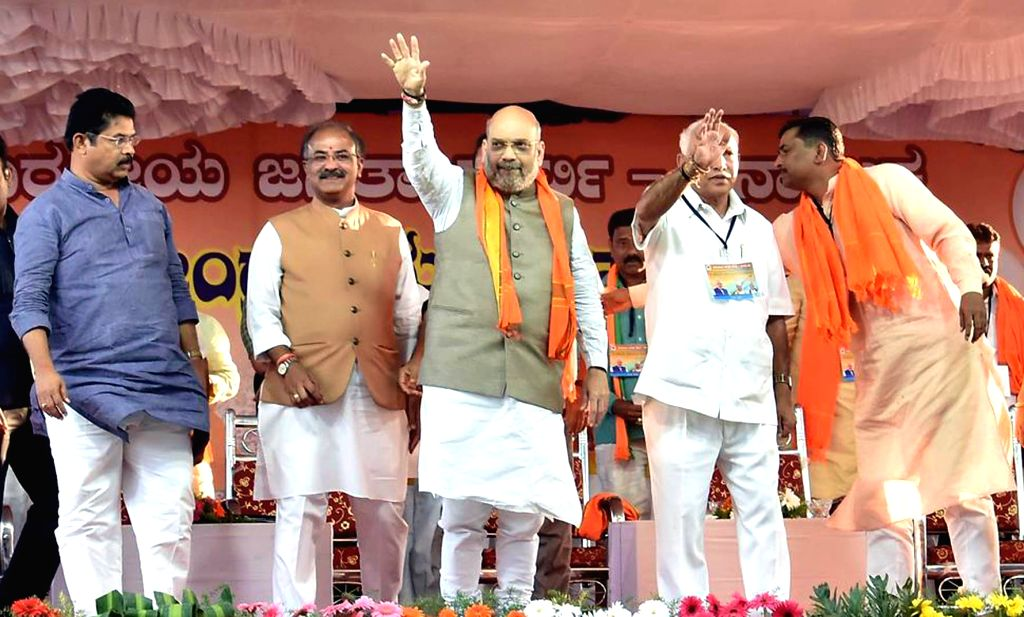 BJP chief Amit Shah addresses a party meeting in Karnataka's Devanahalli, on Feb 21, 2019. - Amit Shah
