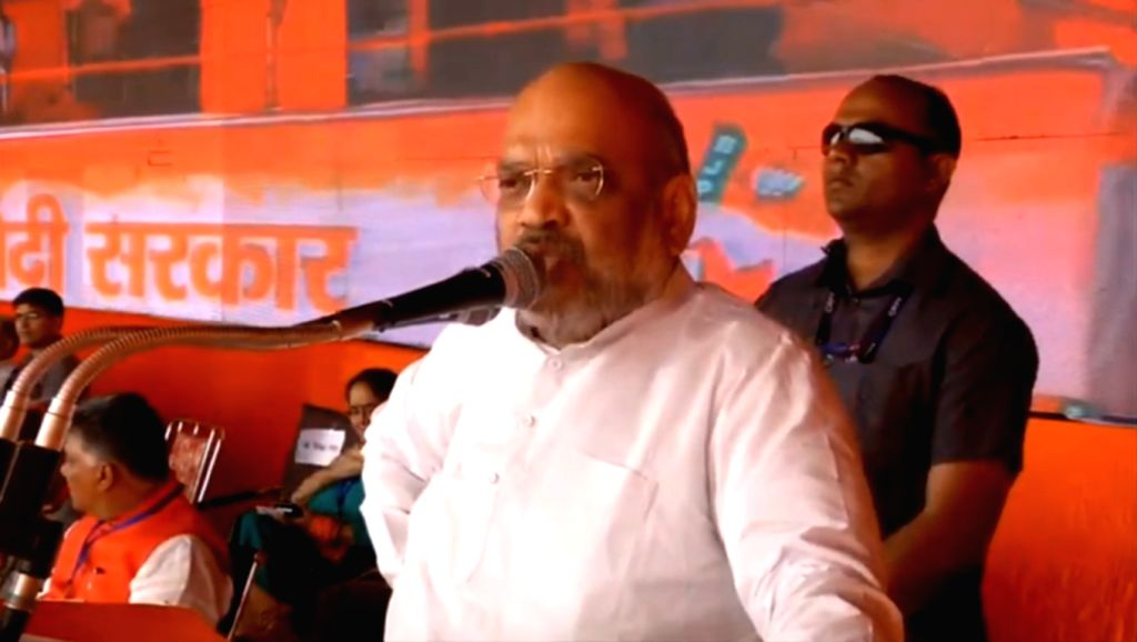 BJP chief Amit Shah addresses a party rally in Himachal Pradesh's Chamba on May 12, 2019. - Amit Shah