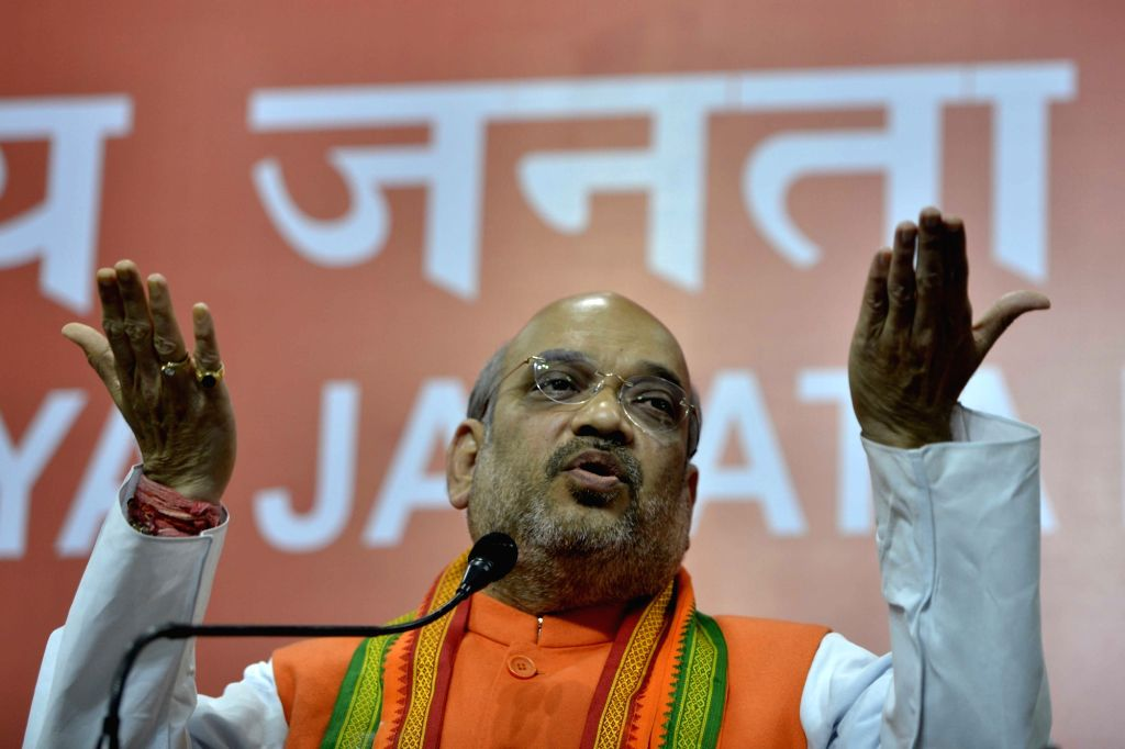 BJP chief Amit Shah addresses a press conference regarding party's performance in the assembly elections in New Delhi on March 11, 2017. - Amit Shah