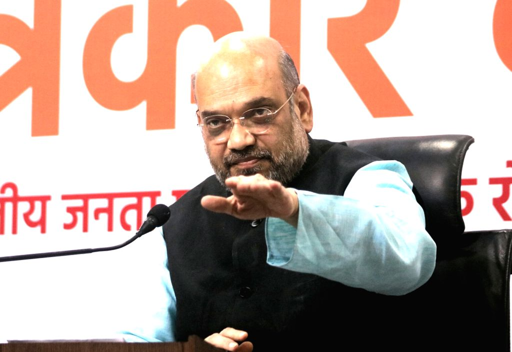 BJP chief Amit Shah addresses a press conference in New Delhi on May 26, 2017. - Amit Shah