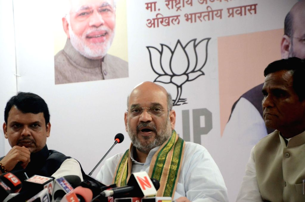 BJP chief Amit Shah addresses a press conference in Mumbai on June 17, 2017. Also seen Maharashtra Chief Minister Devendra Fadnavis. - Devendra Fadnavis and Amit Shah