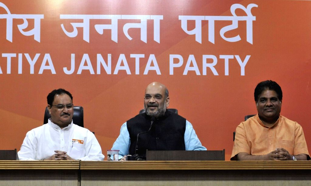 BJP chief Amit Shah addresses a press conference in New Delhi on June 19, 2017. Also seen party leaders Bhupender Yadav and JP Nadda. - Amit Shah and Bhupender Yadav