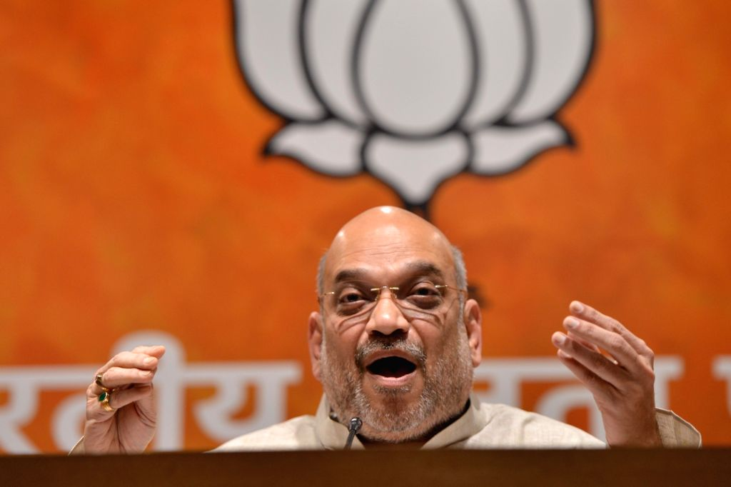 BJP chief Amit Shah addresses a press conference, at the party's headquarter in New Delhi on May 21, 2018. - Amit Shah